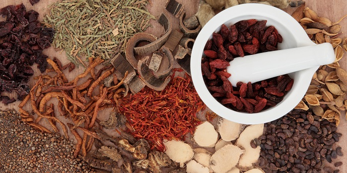 Traditional chinese herbal medicine selection with mortar and pe